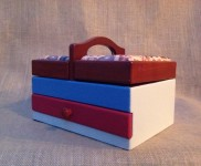 Here is a little sewing box , painted blue and red, perfect for your sewing kit, needles, pins and thread.