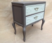 French two drawer cabinet with charming and attractive detail, together with quaint metal handles