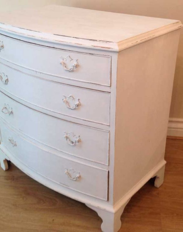 Bow fronted four drawer chest.. Painted in colour Pebbles, slightly distressed
