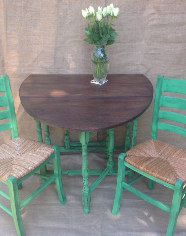 Table and chairs painted with Annie Sloan chalk paint, colour 'Antibes Green' with a dark wax applied.