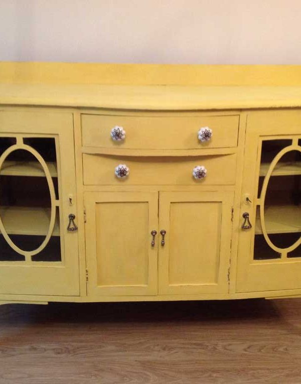 Sideboard with glass fronted doors. Colour English Yellow
