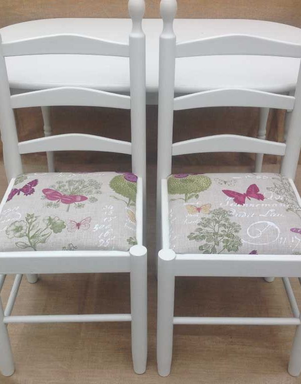 Small oval table with two chairs Seats reupholstered with pretty butterfly material