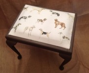Neat little stool, re-upholstered with lovely dog material & painted with autentico chalk paint in colour 'brown', coated with a clear wax