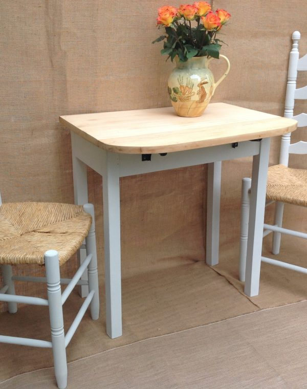 Solid wood drop leaf table, with the drop leaf on one side and high back rush seat chairs