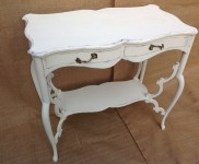Lovely shaped top occasional table with under tier painted with autentico chalk paint in colour 'regency white ' with a delicate touch of 'lavender' to highlight the lovely detail. With pretty metal handles