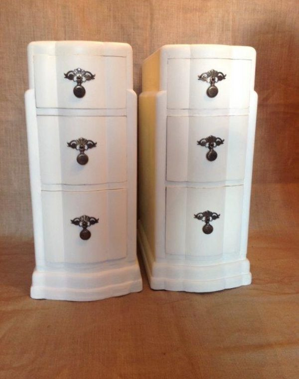 Bedside cabinets with pretty original metal handles. Painted in colour Regency White and completed with a clear wax