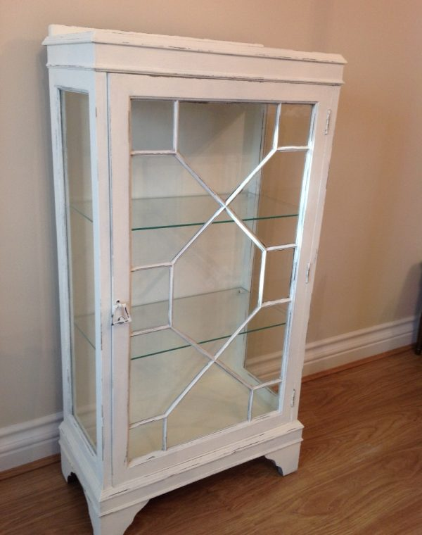 Glass fronted cabinet with two glass shelves.. Painted with Autentico chalk paint  in colour 'Ivory'
