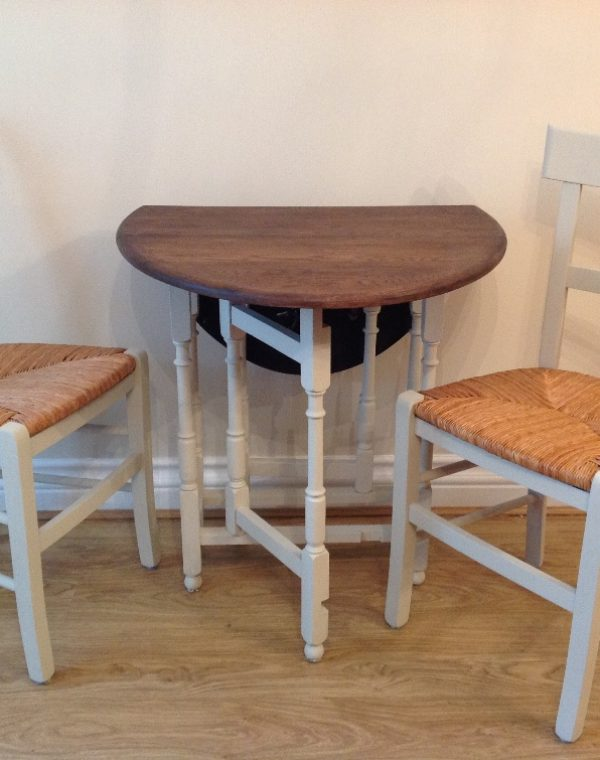 Table with two rush seat chairs. Painted in colour Almond