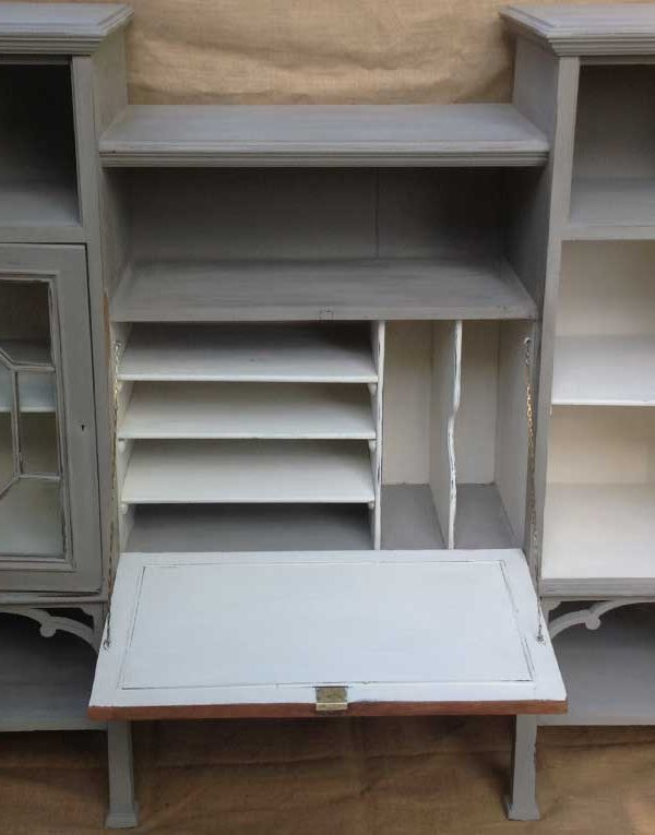 Mahogany display unit with two side cupboards and a centre bureau.