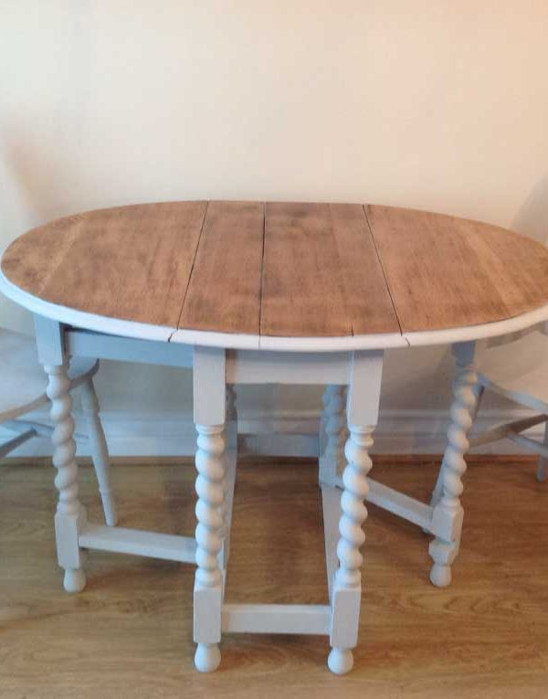 Oak drop leaf table with two wheel back chairs.. Painted in colour Gris
