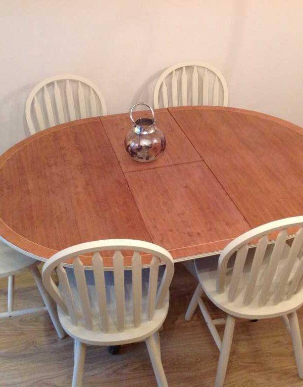 Oval table with centre leaf together with six spindle back chairs.