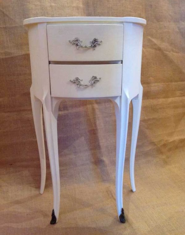 Small two drawer side table with tapered legs together with attractive metal detail